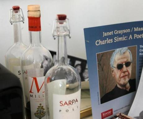 A photo of his father arm wrestling and a few bottles of grapa can be found in his office.